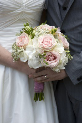 15167133-bride-and-groom-with-wedding-bouquet-of-white-and-pink-roses